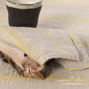 Natural linen color napkin with yellow stripes